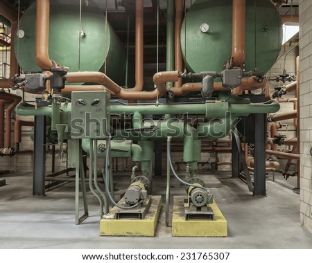 Hot water pumping system including tanks, piping, valves, pumps, electrical controls - stock photo