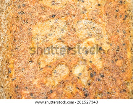 Hot whole wheat bread colling on a board. - stock photo
