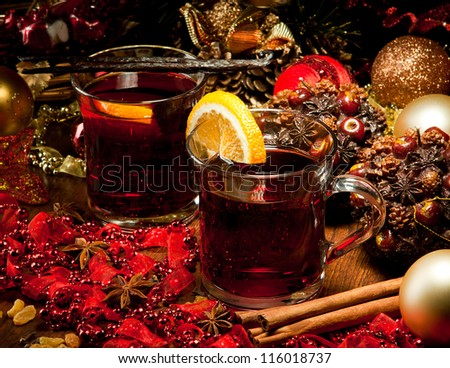 Hot wine for winter and Christmas with delicious cookies and decoration - stock photo