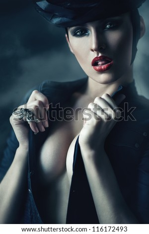 hot woman in black showing tongue - stock photo