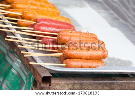 Hotdog placed in trays for sale on the market. - stock photo