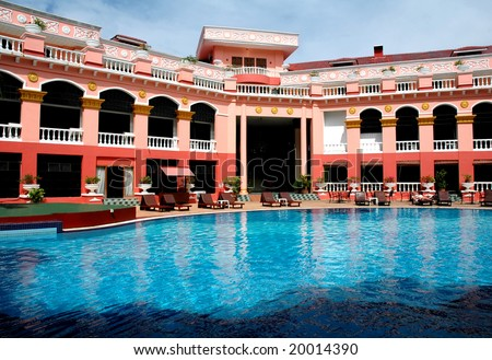 hotel and swimming pool - stock photo