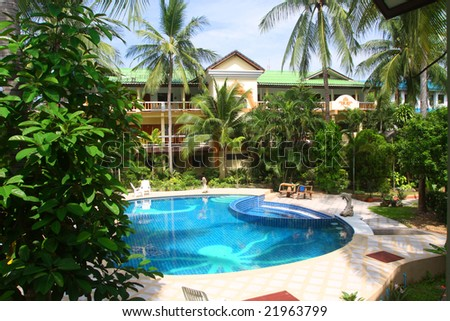 hotel and swimming pool in thailand - stock photo