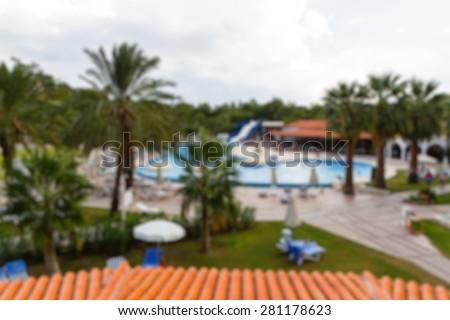 hotel area buildings with swiming pool abstract blur background - stock photo