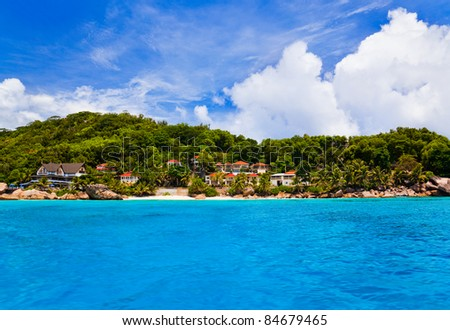 Hotel at tropical beach - vacation background - stock photo