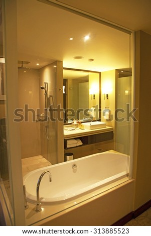 Hotel bathroom with amenities and shower - stock photo