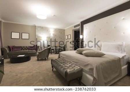 Hotel bedroom interior - stock photo