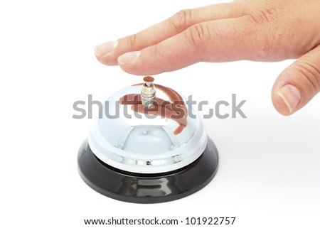 Hotel bell and hand - stock photo
