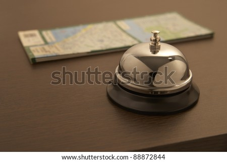 hotel bell with travel map - stock photo