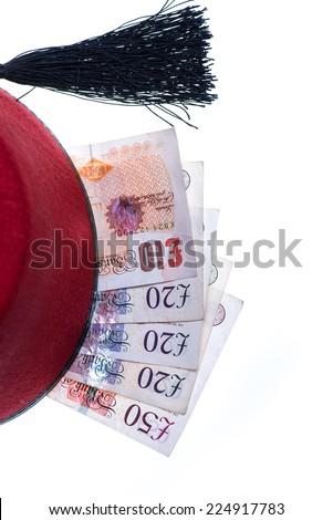 hotel boy hat and money isolated on white - stock photo