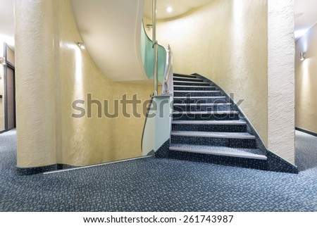 Hotel corridor with stairs - stock photo