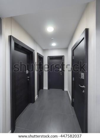 Hotel hallway doors - stock photo