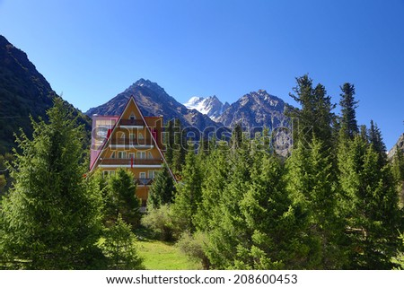 Hotel in mountains.  picturesque resort in summer. Kyrgyzstan. - stock photo