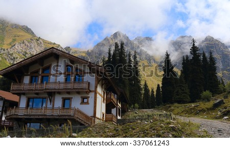 Hotel in Swiss Alps mountains - stock photo