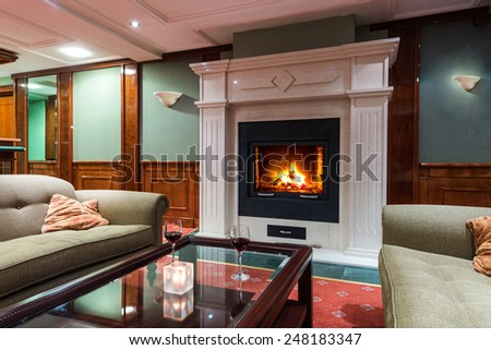 hotel lobby interior with fireplace - stock photo
