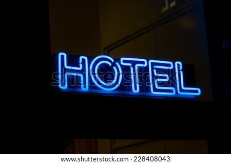 Hotel neon sign - stock photo