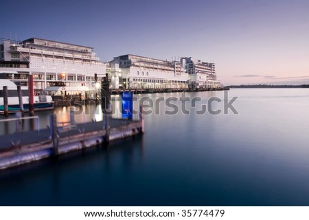 Hotel on Auckland Harbour, New Zealand, at first light. - stock photo