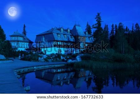 Hotel on moonlight in High Tatras in Slovakia - stock photo