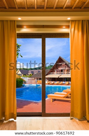 Hotel room and water pool - vacation concept background - stock photo
