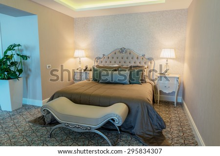 Hotel room with modern interior - stock photo