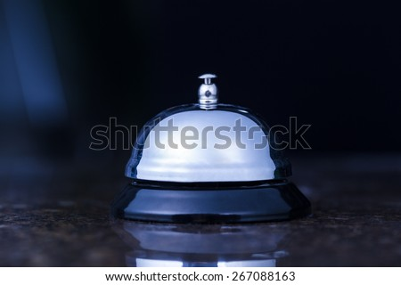 Hotel. Service bell at an hotel table. - stock photo