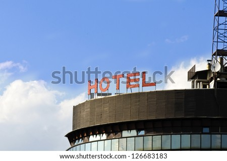 Hotel sign on the sky - stock photo