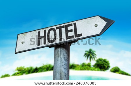 Hotel sign with a beach on background - stock photo