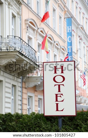Hotel signboard before an entrance - stock photo