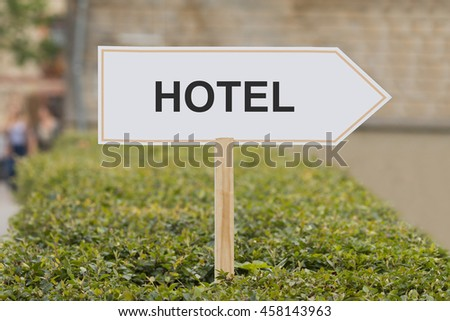 hotel signpost - stock photo