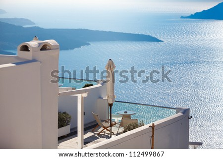 Hotel terrace at Santorini island in Greece with view to the volcanic caldera - stock photo