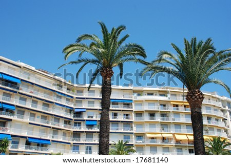 Hotel with palmtrees in the french city Cannes - stock photo