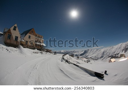 Hotels in winter snowy mountains at night. Georgia. Ski resort Gudauri. Caucasus Mountains. - stock photo