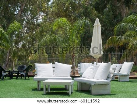 Hotels patio .A Summer view of a  garden . - stock photo