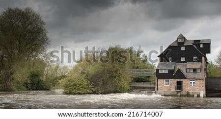 Houghton Mill in floods - stock photo