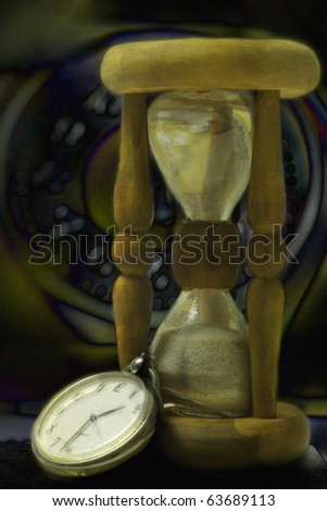 Hourglass and clock. Night time concept still-life - stock photo