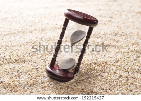 hourglass on sand background - stock photo