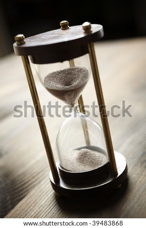 hourglass, selective focus on center of photo, special toned f/x - stock photo
