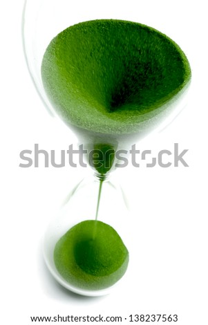 Hourglass with green sand and top view - stock photo