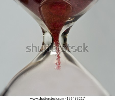 Hourglass with red sand - stock photo