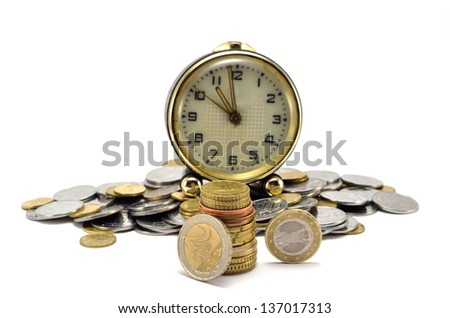 hours and a lot of coins on a white background - stock photo