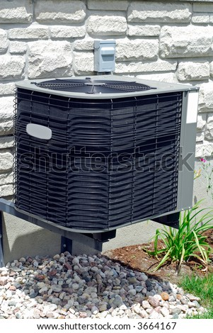 House Air Conditioning Unit Outside A Home - stock photo
