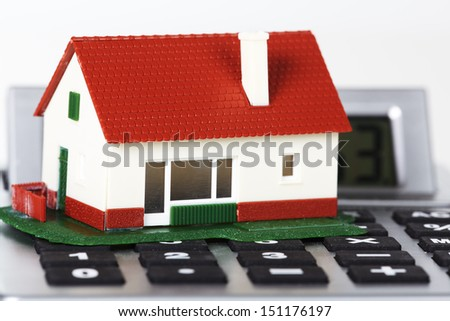 House and calculator. Real estate concept background. - stock photo