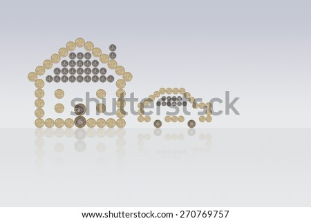 House and Car made out of British Pound Coins - stock photo