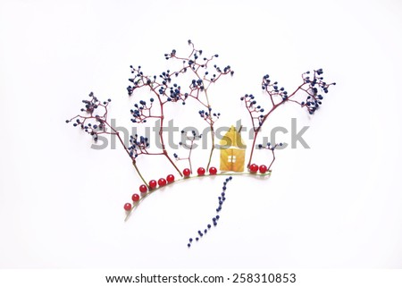 house and trees made of leafs and berries - stock photo