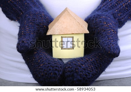 House and winter gloves on the white background - stock photo