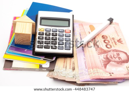 house, Bank book, a calculator, a pen, banknote. The concept of financial planning to buy a home. Financial tools - stock photo