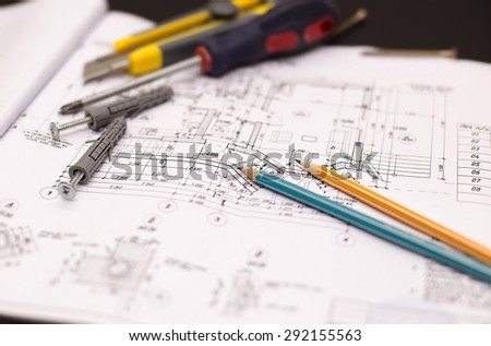 house blueprint with work tools, close-up. - stock photo