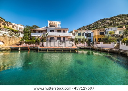 house by the water in Poltu Quatu, Sardinia - stock photo