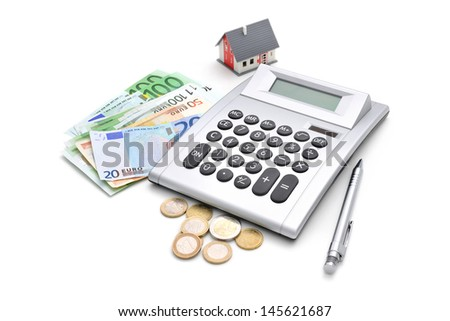 House, calculator and money isolated on white background - stock photo