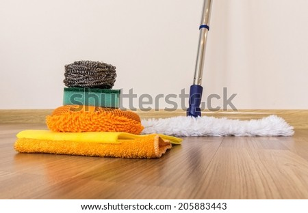 House cleaning -Cleaning accessories on floor  - stock photo